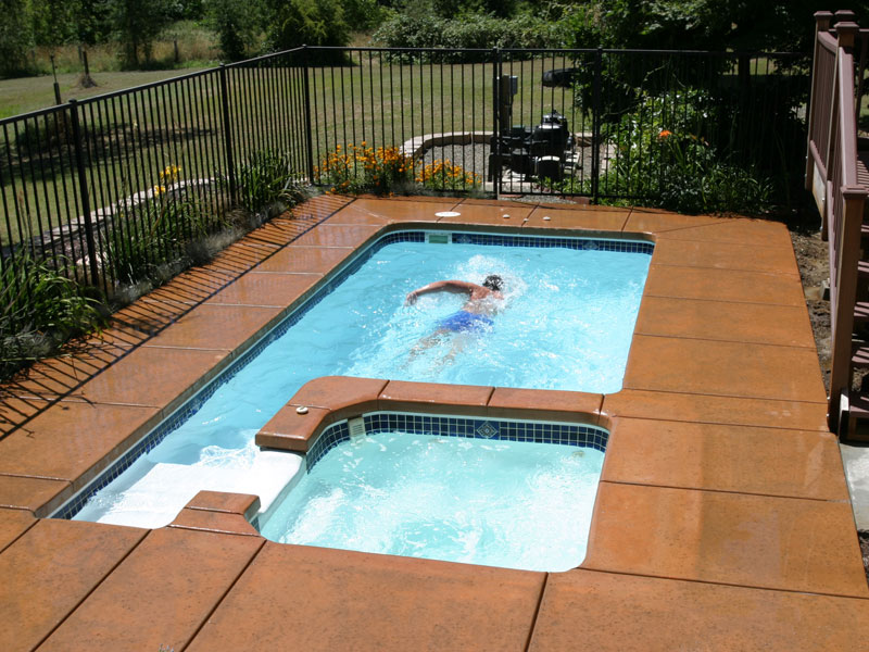 Composite swim spa jacksonville hot tubs and spas for Swimming pool with spa